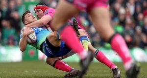 Connacht's Tom Farrell is tackled by Gloucester's Ben Morgan. Photograph: Tommy Dickson/Inpho