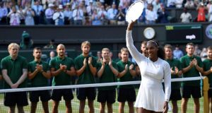 Serena Williams with the runners-up trophy after her Wimbledon final defeat to Angelique Kerber. Photograph: Toby Melville/Reuters