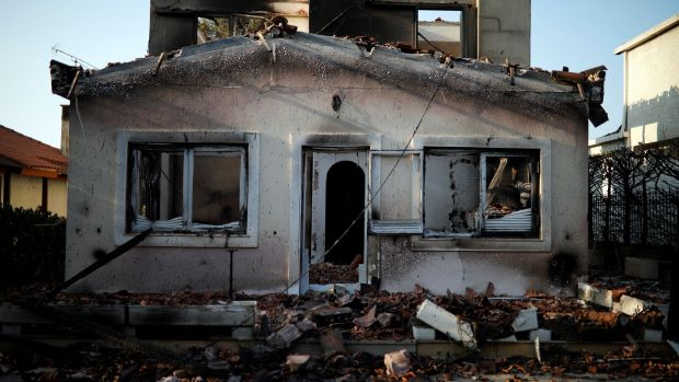 A burnt house following a wildfire at Mati, Greece. Photograph: Alkis Konstantinidis/Reuters