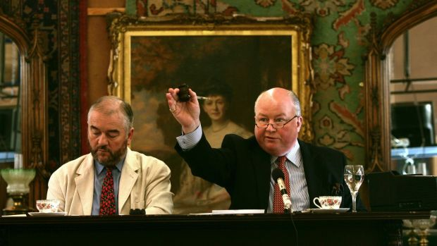 Fonsie left, and George Mealy conducting a fine art and antique auction at their Auction Galleries in Castlecomer, Co Kilkenny in 2005. Photograph: Matt Kavanagh
