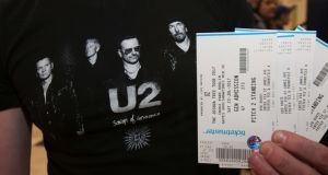A U2 fan with tickets for a Dublin gig. The Government has announced plans to tackle price gouging by online ticket touts. Photograph: Gareth Chaney/Collins