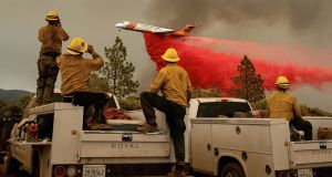 Firefighters watch as an air tanker drops retardant while battling the Ferguson fire in the Stanislaus National Forest, near Yosemite National Park,  on July 21st, 2018. Photograph: Noah Berger/AFP/Getty Images