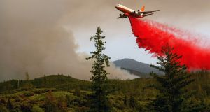 An air tanker drops retardant while battling the Ferguson fire in the Stanislaus National Forest, near Yosemite National Park on July 21st. Photograph: Noah Berger/AFP/Getty Images