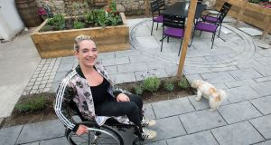 Louise Bruton in her newly renovated, wheelchair-friendly garden. Photograph: Dave Meehan