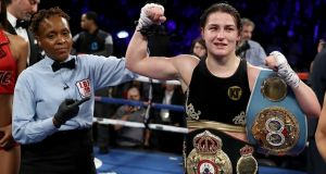 Katie Taylor celebrates her win over Victoria Bustos  after their WBA & IBF world lightweight title unification bout in New York City. Photograph:  Elsa/Getty Images