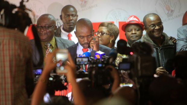 Nelson Chamisa (centre) head of the MDC opposition alliance at the party headquarters in Harare, Photograph: Tsvangirayi Mukwazhi/AP