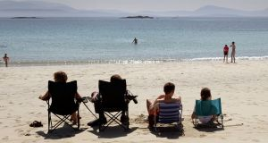 Enjoying the good weather at O'Carrolls Cove, near Waterville, Co Kerry. Photograph: Frank Miller