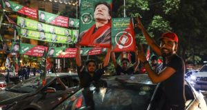 Supporters of Imran Khan celebrate on a street in Lahore, Pakistan. Photograph: Asad Zaidi/Bloomberg