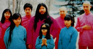 An undated  photo  shows cult leader Shoko Asahara (centre, back) with his wife Tomoko (left, front) and daughter Archery (centre, front) along with members of his  inner group of disciples. Phootograph:  EPA/HO
