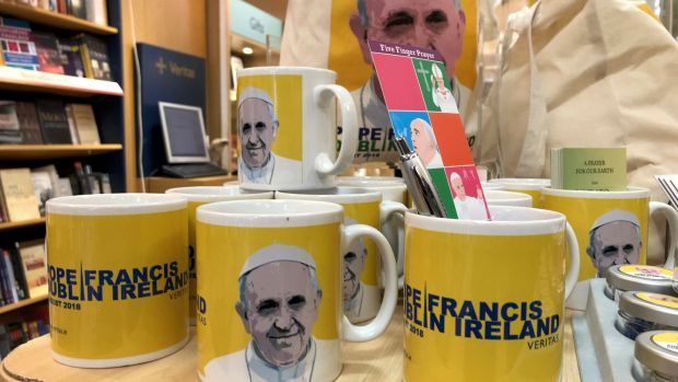 Pope Francis mugs among some of the range of memorabilia and souvenirs on sale at the Veritas store on Dublin's Abbey Street. Photograph: Bryan O'Brien
