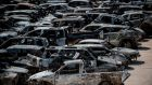 Burnt-out cars parked outside a football stadium following a wildfire at the village of Rafina, near Athens. Photograph:  Angelos Tzortzinis/AFP/Getty Images