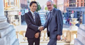 "SoftBank's vice president of global business strategy Hidebumi Kitahara and Owen Keegan, chief executive, Dublin City Council. ""SoftBank has a great vision for the city of the future,"" said Mr Keegan"
