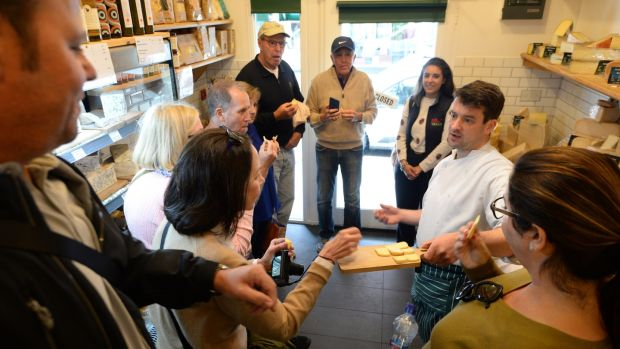 The group samples some cheeses from Sheridan's Cheesemongers, served up by Michael Conefrey. Photograph: Dara Mac Dónaill