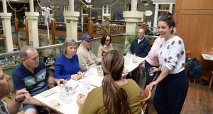 The group visits the Pepper Pot cafe in the Powerscourt Centre in Dublin. Photograph: Dara Mac Dónaill