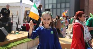 Just over one-third of the people  surveyed by the Department of Foreign Affairs about living in Asia had children currently residing with them. Photograph: St Patrick's Day Parade, Shanghai