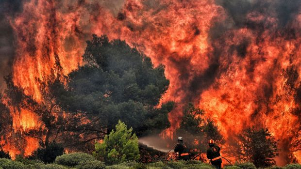 A wildfire blazing within 30km of Athens on July 24th. Thousands of people have fled their homes, and more than 80 people have died. Photograph: Getty Images