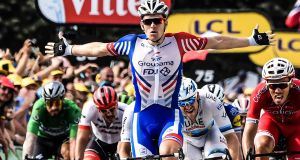 France's Arnaud Demare celebrates as he crosses the finish line to win the 18th stage  of the Tour de France  between Trie-sur-Baise and Pau. Photograph: Jeff Pachoud/AFP/Getty Images