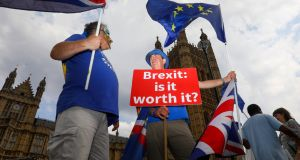 Demonstrators hold Union Jack flags and European Union (EU) flags during an anti-Brexit protest outside the Houses of Parliament in London on Tuesday. Photograph: Simon Dawson/Bloomberg