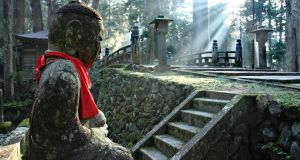 A file image of Okunoin cemetery at Mount Koya in Japan. A Buddhist priest whose grumpy responses to negative hotel reviews went viral this week has vowed to tone down his responses. Photograph: iStock.
