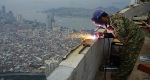 "A worker on a skyscraper in Xiamen,  China: the ""Capability Triad"" is  a sweet spot of economic progress where skill development, the improved production of goods and organisational change overlap.  Photograph: Reuters"