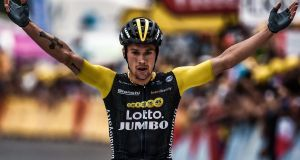 Slovenia's Primoz Roglic celebrates as he crosses the finish line to win the 19th stage of  the Tour de France  between Lourdes and Laruns. Photograph: Marco Bertorello