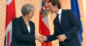 Austrian chancellor Sebastian Kurz and Britain's prime minister Theresa May shake hands prior to a meeting in the hotel Sacher in Salzburg, Austria on Friday. Photograph: Kerstin Joensson/AP.