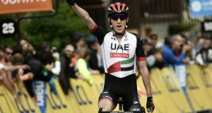 Dan Martin celebrates victory in stage six of the Tour de France. Photograph: Philippe Lopez/AFP/Getty