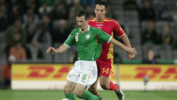 Ireland's Liam Miller challenged by Dejan Damjanovic of Montenegro during a World Cup qualifier in 2009. Photograph: Morgan Treacy/Inpho
