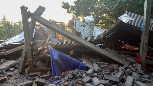 A collapsed house after an earthquake struck in Lombok, Indonesia. Photograph: EPA/Handout