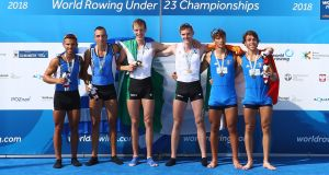 David O'Malley (centre left) and Shane Mulvaney (centre right) celebrate gold in the lightweight men's pair at the World Rowing Under 23 Championships in Poznan. Photograph: FISA Igor Meijer