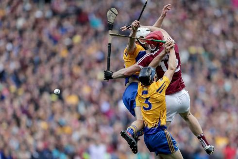 Galway vs Clare Galway's Jonathan Glynn with David McInerney and Patrick O'Connor of Clare Photo: INPHO/Laszlo Geczo
