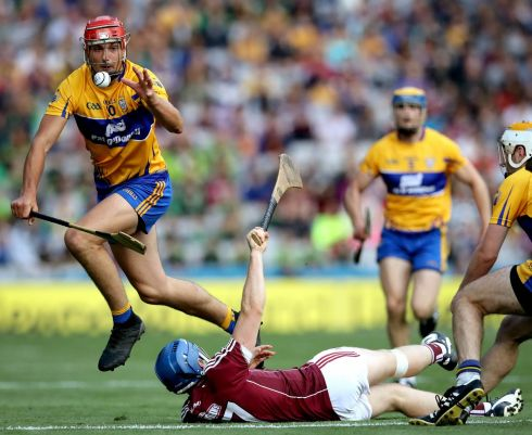 Galway's Paul Killeen with Peter Duggan of Clare Photo: INPHO/Ryan Byrne