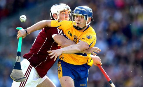 Galway's Daithi Burke and Padraic Collins of Clare Photo: INPHO/Ryan Byrne