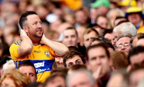 A Clare fan reacts in the closing moments of normal time Photo: INPHO/James Crombie