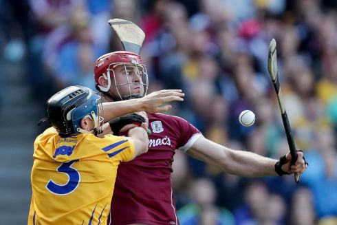 Clare's David McInerney and Jonathan Glynn of Galway Photo: INPHO/Laszlo Geczo