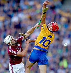 Galway's Gearoid McInerney and Peter Duggan of Clare Photo: INPHO/James Crombie