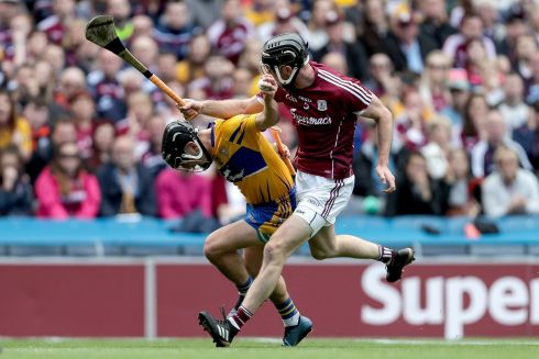 Clare's David Reidy and Padraig Mannion of Galway Photo: INPHO/Laszlo Geczo