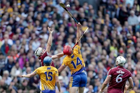 Galway's Daithi Burke and John Conlon of Clare Photo: INPHO/Laszlo Geczo