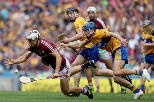 Galway's Daithi Burke with Shane O?Donnell of Clare Photo: INPHO/Tommy Dickson
