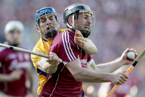 Galway's Padraig Mannion and Shane OoDonnell of Clare Photo: INPHO/Laszlo Geczo