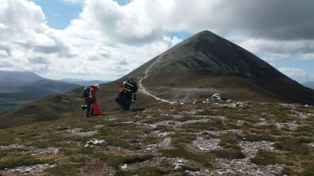 Mayo Mountain Rescue said it had treated a number of individuals, including a 71-year-old woman who was dehydrated, a 46-year-old man evacuated by Air Corps helicopter to hospital for chest pain and a 54-year-old man with an ankle injury. Photograph: Mayo Mountain Rescue/Twitter