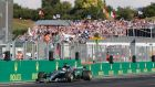 Lewis Hamilton crosses the finish line in Hungary. Photograph: Bernadett Szabo/Reuters