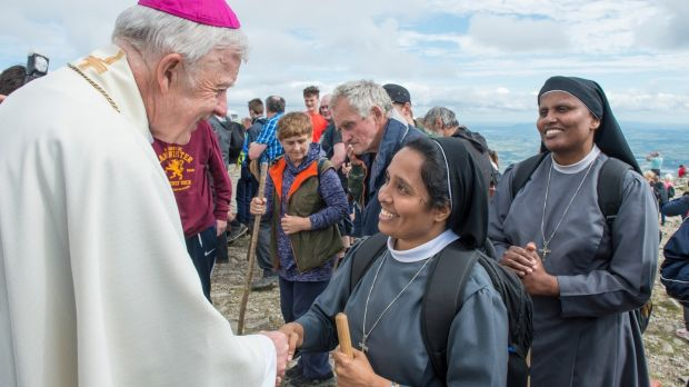 Archbishop Michael Neary greets Sr Mareena and Sr Jasmine based at the Ursuline Convent, Portlaoise. Photograph: Michael McLaughlin