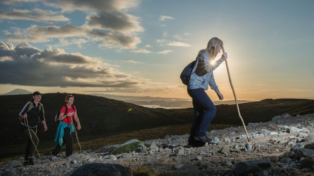 Pilgrims make their way up the rugged slopes of Croagh Patrick at sunrise. Photograph: Michael McLaughlin