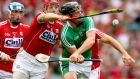 Cork's Bill Cooper blocks Peter Casey of Limerick during the All-Ireland semi-final at Croke Park. Photograph: James Crombie/Inpho-