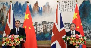 Chinese foreign minister Wang Yi, right, with UK foreign secretary Jeremy Hunt at a press briefing at the Diaoyutai State Guesthouse in Beijing on Monday, July 30th, 2018. Photograph: Andy Wong/AP