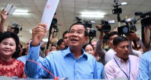 Cambodia's prime minister Hun Sen  prepares to cast his vote in a general election on Sunday in whicn is party claims ti have won all 125 seats in parliament. Photograph:  Manan Vatsyayana/AFP/Getty Images