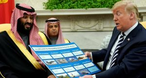 US president Donald Trump holds a chart of military hardware sales as he welcomes Saudi Arabia's Crown Prince Mohammed bin Salman in Washington in  March 2018. Photograph: Jonathan Ernst/Reuters