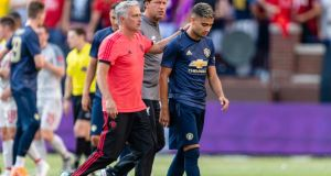 Jose Mourinho leaves the pitch with Andreas Pereira following Manchester United's 4-1 defeat to Liverpool. Photo: Jason Miller/Getty Images