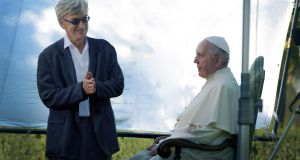 German director Wim Winders with Pope Francis, the subject of his latest documentary.